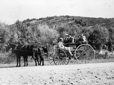 Dr Hugh Douglas and family on 4 wheel buggy