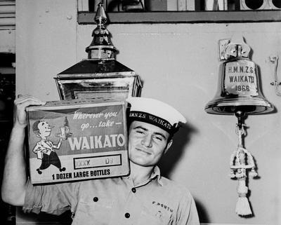 O/S F Poutu carrying beer onto HMNZS Waikato 1966