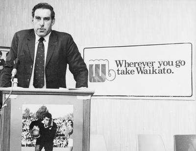 Colin Meads at a podium