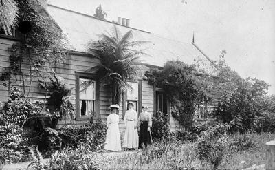 Three women outside house