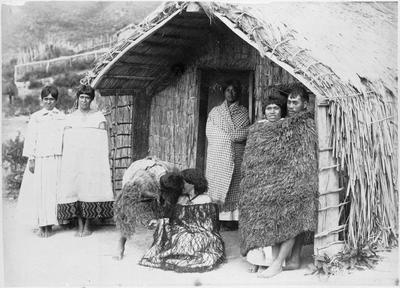 Maori group outside whare