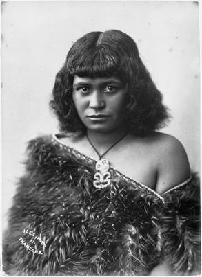 Young Maori woman in Kiwi feather cloak