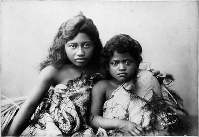 Two children wearing korowai