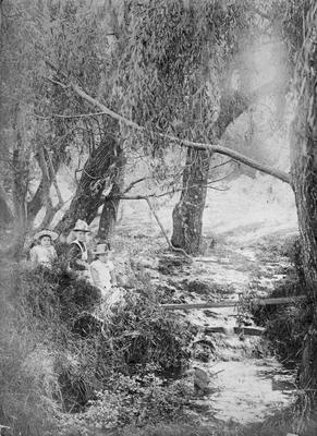 Children beside stream