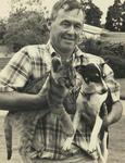 Murray Powell with leopard/lion cub and dog