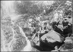 Women and children at waterfall